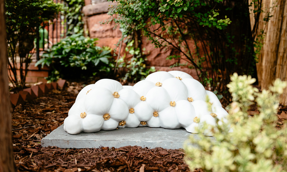 Jonathan Monaghan's 2015 marble sculpture with the appearance of soft fabric, installed in a outdoor sculpture biennial